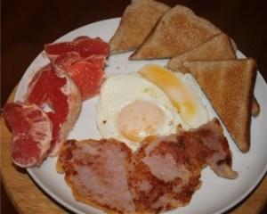 Eggs, peameal bacon, toast, grapefruit