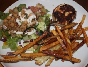 Bacon wrapped chicken, fries and chickpea, lentil tossed salad